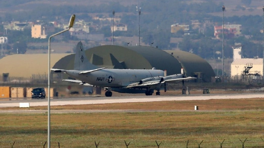 "FILE - In this July 28, 2015 file photo, a U.S. Navy plane maneuvers on the runway of the Incirlik Air Base, in Adana, in the outskirts of the city of Adana, southeastern Turkey. The State Department and Pentagon ordered the families of U.S. diplomats and military personnel Tuesday, March 29, 2016, to leave posts in southern Turkey due to ""increased threats from terrorist groups"" in the country. The two agencies said dependents of American staffers at the U.S. consulate in Adana, the Incirlik air base and two other locations must leave. The so-called ""ordered departure"" notice means the relocation costs will be covered by the government. (AP Photo/Emrah Gurel, File)"
