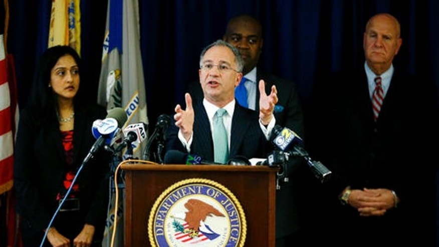 Paul Fishman, front, U.S. attorney for the District of New Jersey, stands with Vanita Gupta, left, principal deputy assistant attorney general for the U.S. Department of Justice Civil Rights Division, Newark Mayor Ras Baraka, center back, and Anthony Ambrose, right, Newark public safety director, while speaking during a news conference, Wednesday, March 30, 2016, in Newark, N.J.