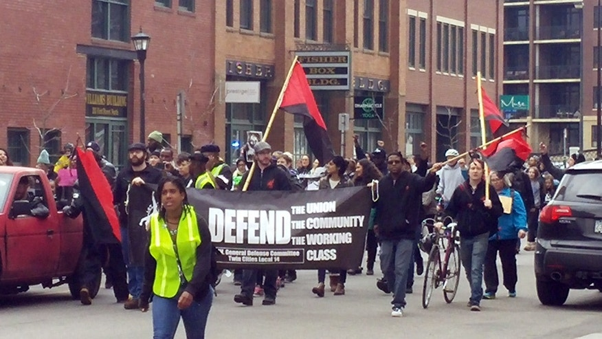 Protesters marched in Minneapolis on Saturday demanding prosecution of two officers in the Jamar Clark case.