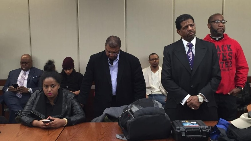 Community leaders listen as Hennepin County Attorney Mike Freeman announces that two Minneapolis police officers, Officers Mark Ringgenberg and Dustin Schwarze, will not be charged in the November fatal shooting of Jamar Clark , a black man, during his press conference Wednesday, March 30, 2016 in Minneapolis. Clark was shot by police Nov. 15 during what authorities called a struggle. But some people who say they saw the shooting have said Clark wasn't struggling and was handcuffed. Clark died a day later. (Jim Gehrz/The Star Tribune via AP)