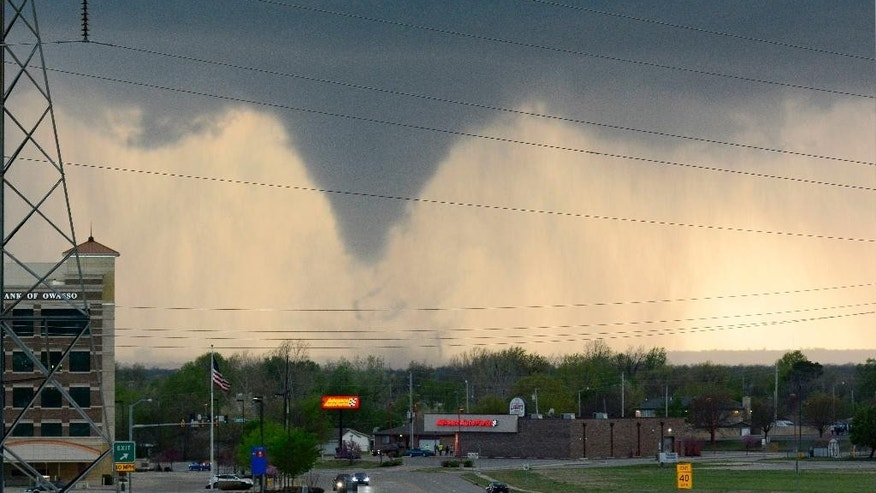 A tornado touches down in Tulsa, Okla., on Wednesday, March 30, 2016. The National Weather Service is confirming multiple tornado touchdowns in the Tulsa area. (AP Photo/Larry Papke)