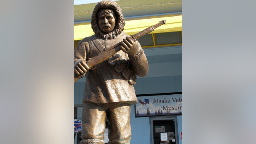 FILE - This file photo taken Thursday, April 26, 2012, in Anchorage, Alaska, shows a bronze statue honoring the Alaska Territorial Guard, a pre-statehood militia formed to protect the vast territory from the threat of Japanese aggression during World War II. U.S. Rep. Don Young is urging federal officials to replace rotting wooden markers with permanent headstones at the graves of the Territorial Guard members. (AP Photo/Rachel D'Oro,File)