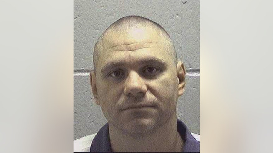 Georgia death row inmate Joshua Bishop is shown in this undated prison photo released Tuesday, March 29, 2016 by the Georgia Department of Corrections. The State Board of Pardons and Paroles announced that it will hear from advocates for Bishop on March 30, 2016. Bishop is scheduled to die the next day. Bishop was convicted of murder and armed robbery in the 1994 beating death of Leverett Morrison in Milledgeville, Ga. The parole board is the only entity in Georgia authorized to commute a death sentence. (Georgia Department of Corrections via AP)