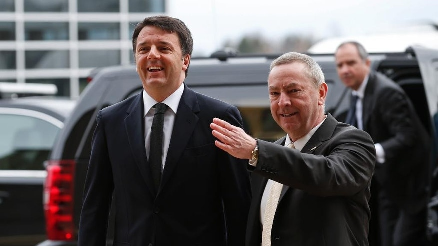 FILE - Italy's Prime Minister Matteo Renzi, left, arrives at Fermi National Accelerator Laboratory for a tour in Batavia, Ill., Wednesday, March 30, 2016. Renzi will deliver an address at Harvard University as he continues a four-day U.S. visit. Renzi is scheduled to speak on Thursday after first touring an IBM research facility in Cambridge.  (AP Photo/Kamil Krzaczynski, File)