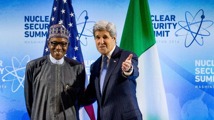 Secretary of State John Kerry meets with Nigerian President Muhammadu Buhari at the Nuclear Security Summit, Thursday, March 31, 2016, at the Walter E. Washington Convention Center in Washington. (AP Photo/Andrew Harnik)
