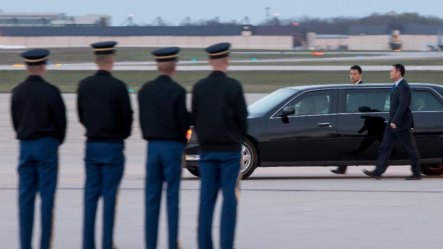 A car carrying Chinese President Xi Jinping departs Andrews Air Force Base, Md., Wednesday, March 30, 2016. Xi is in Washington to attend the Nuclear Security Summit. (AP Photo/Andrew Harnik)
