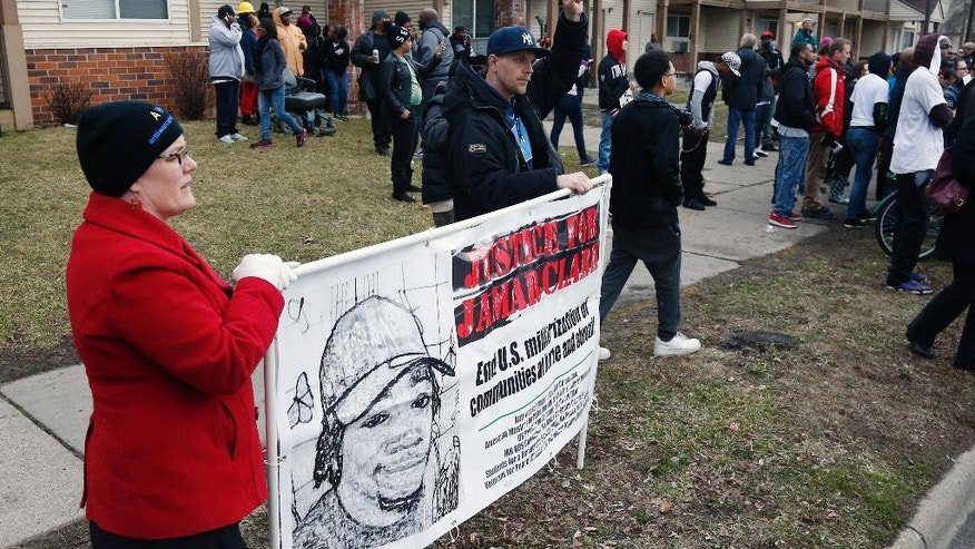 Demonstrators gather to protest Wednesday, March 30, 2016, in Minneapolis, after County Attorney Mike Freeman's announcement that no charges will be filed against two Minneapolis police officers in the fatal shooting of Jamar Clark. (AP Photo/Jim Mone)
