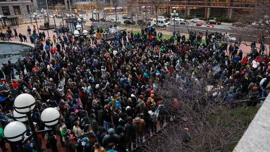 Hundreds of protesters representing numerous groups protest at the Government Center in Minneapolis Wednesday evening, March 30, 2016 following a decision earlier in the day by County Attorney Mike Freeman that no charges will be filed against two Minneapolis police officers in the fatal shooting of a black man, Jamar Clark, last November. (AP Photo/Jim Mone)