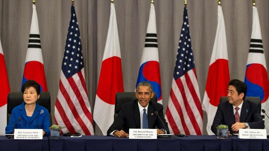 President Barack Obama meets with South Korean President Park Geun-hye, left, and Japanese Prime Minister Shinzo Abe during the Nuclear Security Summit in Washington, Thursday, March 31, 2016. (AP Photo/Jacquelyn Martin)