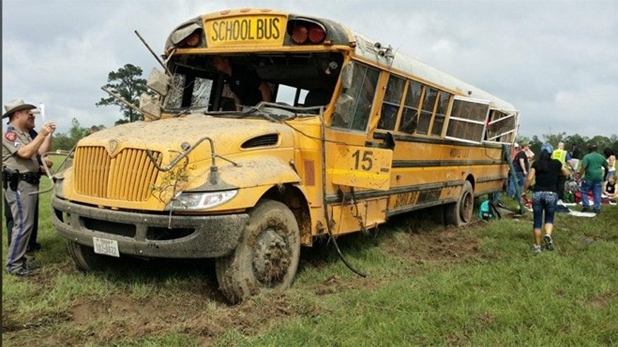 Investigators inspect the school bus after the crash in Texas.