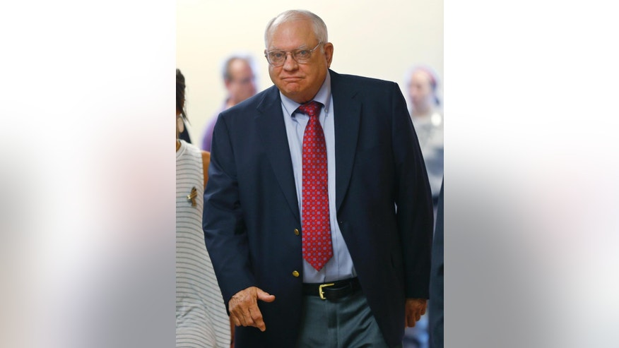 FILE - In this July 13, 2015, file photo, Robert Bates arrives for his arraignment in Tulsa, Okla. The former Oklahoma volunteer deputy is charged with second-degree manslaughter in the fatal shooting of an unarmed man. Video released by an Oklahoma sheriff's office shows Bates pointing a stun gun at a suspected drug dealer and briefly drawing his firearm just weeks before he fatally shot an unarmed man. (AP Photo/Sue Ogrocki, File)