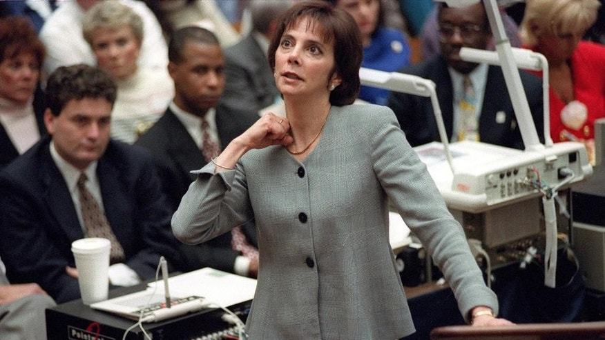 FILE - In this Sept. 29, 1995 file photo, prosecutor Marcia Clark makes her closing arguments during the O.J. Simpson double-murder trial in Los Angeles, demonstrating on her own neck where a knife wound was sustained by murder victim Ronald Goldman. After nearly a month of testing, Los Angeles police detectives have concluded a knife found during demolition of the former Brentwood estate of O.J. Simpson was not the weapon used to kill Simpson's ex-wife Nicole Brown Simpson and her friend Ronald Goldman in 1994. Investigators ruled out the knife after weeks of forensic tests, Police Capt. Andy Neiman said Friday, April 1, 2016.(AP Photo/Reed Saxon, Pool, File)