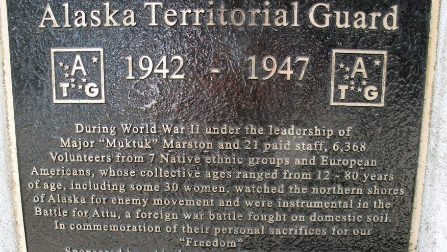 FILE - This Thursday, April 26, 2012, file photo in Anchorage, Alaska, a plaque at the base of a bronze statue commemorates the Alaska Territorial Guard, a pre-statehood militia formed to protect the vast territory from the threat of Japanese aggression during World War II.