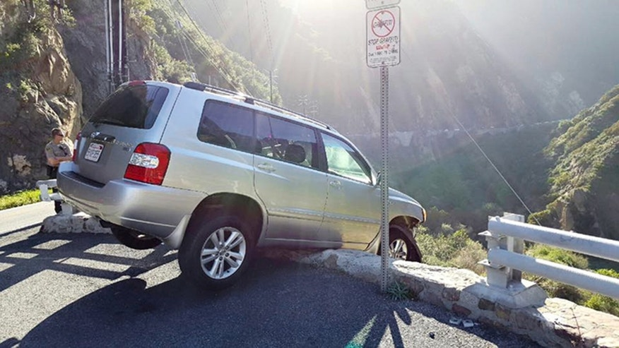 An SUV that broke through a guardrail in Malibu.
