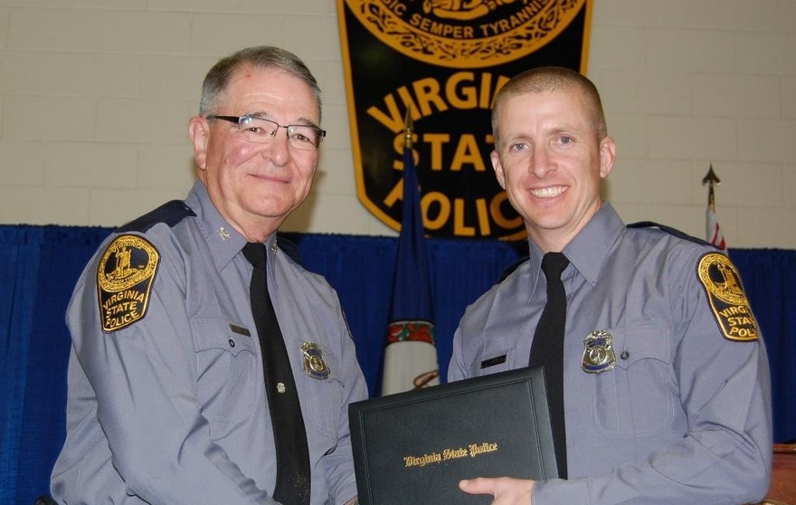 In this November 2014 photo provided by the Virginia State Police, trooper Chad P. Dermyer poses for a photo as he receives his graduation diploma from Superintendent Col. W. Steven Flaherty.  Virginia State Police Superintendent Col. Steven Flaherty says Dermyer, died Thursday, March 31, 2016  after being shot multiple times responding to a call at a Greyhound bus station in Richmond. The gunman was shot dead by two other troopers. (Virginia State Police via AP)