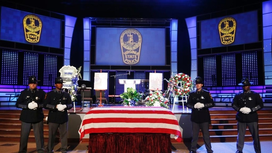 Virginia State Police honor guards stand watch over the coffin of Virginia State Police police officer Chad P. Dermyer prior to the funeral service at the Liberty Baptist Church on Tuesday, April 5, 2016 in Hampton, Va. Dermyer was killed in the line of duty at the Richmond Greyhound bus station last week. (AP Photo/Steve Helber, Pool)