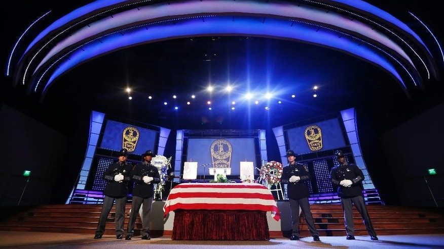 Virginia State Police honor guards stand watch over the coffin of Virginia State Police police officer Chad P. Dermyer prior to the funeral service at the Liberty Baptist Church, Tuesday, April 5, 2016, in Hampton, Va. Dermyer was killed at the Richmond Greyhound bus station last week. (AP Photo/Steve Helber, Pool)