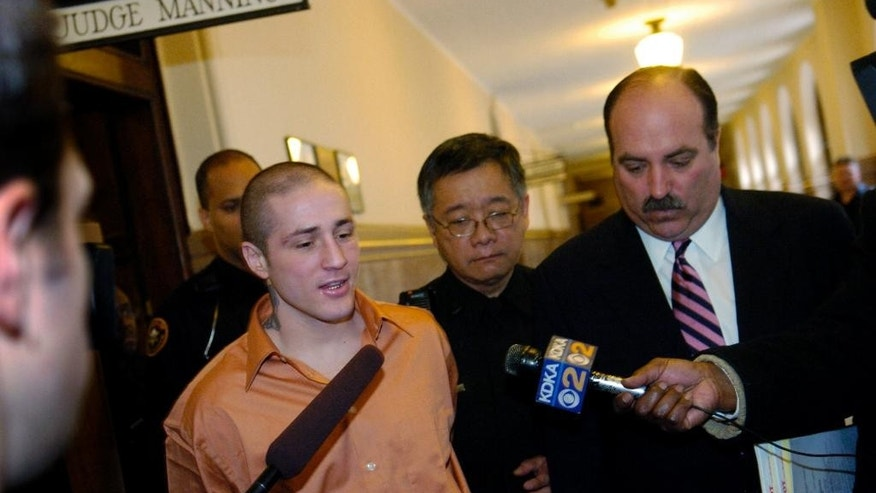 FILE - This file photo from Feb. 23, 2005 shows former IBF lightweight champion Paul Spadafora, left, as he walks with defense attorney William Difenderer after he leaves Judge Jeffery Manning's courtroom in Pittsburgh, Pa. Spadafora was then sentenced to up to five years in state prison for shooting his girlfriend in 2003. Spadafora was just charged Thursday, April 7, 2016 with simple assault and harassment for allegedly throwing a 63-year-old woman to the ground in the parking lot outside a Pittsburgh-area bar. (John Beale/Pittsburgh Post-Gazette via AP, File)