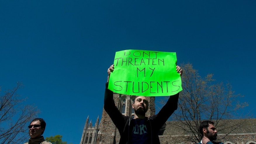 Matteo Gilebbi, center, an Italian instructor at Duke University, during a protest Sunday.
