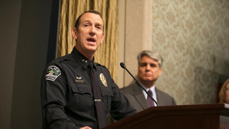 APD Assistant Chief Troy Gay, left, speaks as University of Texas President Gregory L. Fenves, right, listens during a news conference about the death of student Haruka Weiser on Thursday, April 7, 2016 in Austin, Texas. The first-year dance student was the victim of a homicide and police are searching for a man seen near the heart of campus, where her body was found. (Deborah Cannon/Austin American-Statesman via AP)  AUSTIN CHRONICLE OUT, COMMUNITY IMPACT OUT, INTERNET AND TV MUST CREDIT PHOTOGRAPHER AND STATESMAN.COM, MAGS OUT; MANDATORY CREDIT