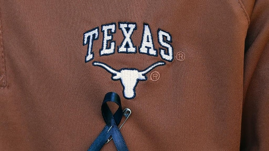 A Texas student wears a black ribbon for fellow student Haruka Weiser on campus, Thursday, April 7, 2016, in Austin, Texas. Weiser, 18, a first-year dance student from Oregon, was last seen leaving a university drama building Sunday night. Her body was discovered in a creek in the heart of the university's Austin campus on Tuesday.(AP Photo/Eric Gay)