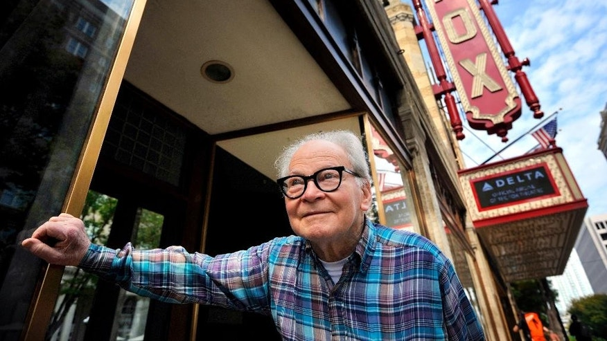 "FILE -In this Tuesday, Oct. 12, 2010 file photo, Joe Patten, 83, known as the ""Phantom of the Fox"", who has lived above the historic Fox Theatre in Atlanta for the past 31 years, stands outside the theatre, in Atlanta.  Patten, who lived above Atlanta's Fox Theatre and is credited with twice helping to save the landmark, has died. He was 89. Patten was a founding trustee of a group created to raise money to save the Fox from demolition in the 1970s. He had lived above the Fox since 1979 and helped save it a second time when a fire started in the early morning hours of April 15, 1996. (AP Photo/Rich Addicks, File)"