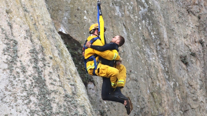 April 7, 2016: Michael Banks is rescued after being stranded on a ledge some 80 off the ground on Morro Rock in Morro Bay, Calif.