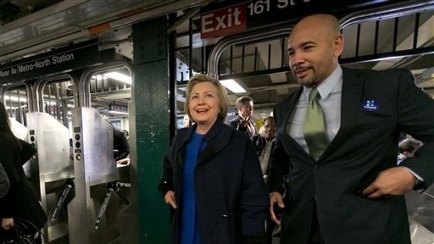 Democratic presidential candidate Hillary Clinton and Bronx Borough President Ruben Diaz Jr. enter  the subway in the Bronx borough of New York, Thursday, April 7, 2016. (AP Photo/Richard Drew)