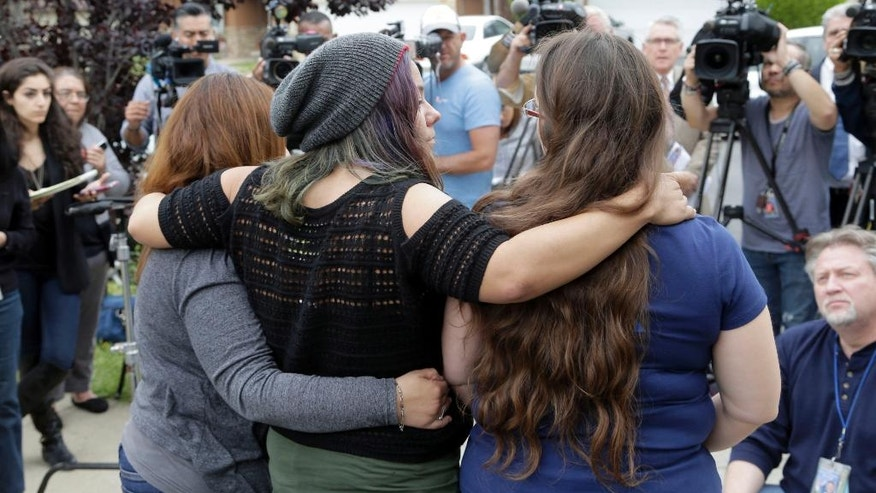 Family and friends of Gabriel Fernandez, an 8-year-old boy who died in 2013, face reporters at a news conference in the Sylmar district of Los Angeles, Thursday, April 7, 2016. Prosecutors charged four Los Angeles County social workers with child abuse, saying they were so negligent in handling the case of the young boy who died of gruesome, multiple injuries that, just like his abusers, they were criminally responsible. Gabriel's mother, Pearl Fernandez, and her boyfriend, Isauro Aguirre, have pleaded not guilty to murder and are in jail awaiting trial. (AP Photo/Nick Ut)