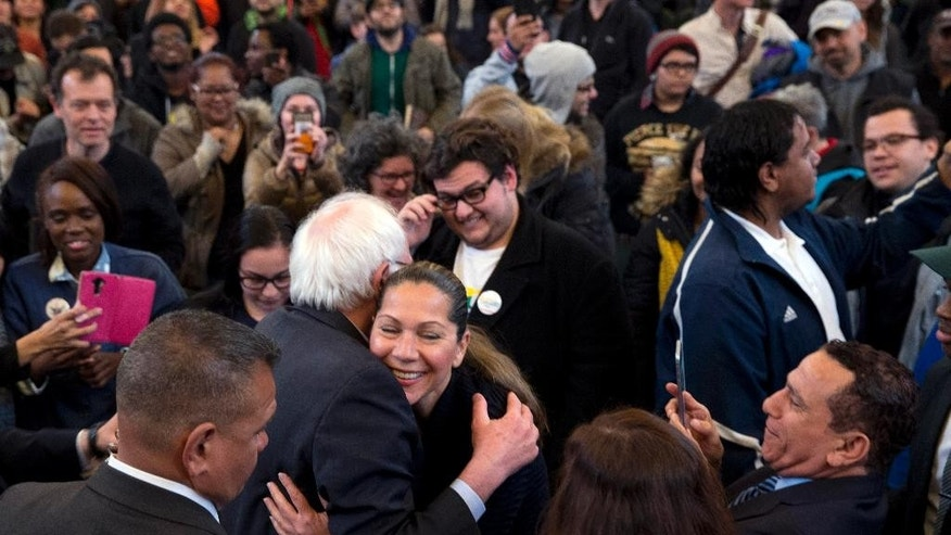 Democratic presidential candidate, Sen. Bernie Sanders, I-Vt., hugs a member of the audience during a campaign event, Saturday, April 9, 2016, in the Bronx borough of New York. (AP Photo/Mary Altaffer)