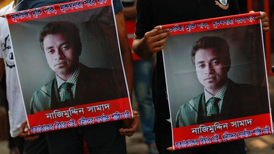 April 8, 2016: People carry portraits of student activist Nazimuddin Samad as they attend a rally to demand arrest of three motorcycle-riding assailants who hacked and shot Samad to death, in Dhaka, Bangladesh.