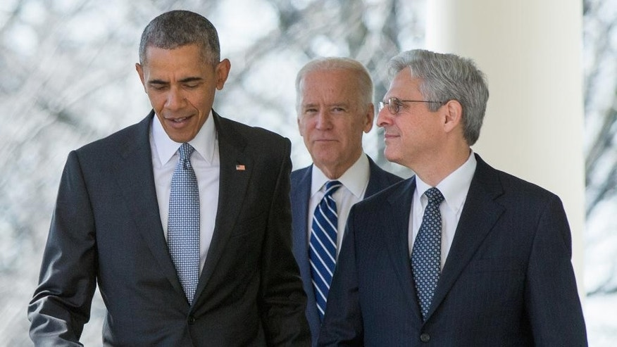FILE - In this photo taken March 16, 2016, Federal appeals court judge Merrick Garland arrives with President Barack Obama and Vice President Joe Biden to be introduced as Obama's nominee for the Supreme Court, during an announcement in the Rose Garden of the White House, in Washington. Garland, has been characterized as a moderate who, if confirmed, would nudge his divided colleagues slightly to the left because he would replace conservative stalwart Antonin Scalia. (AP Photo/Andrew Harnik, File)