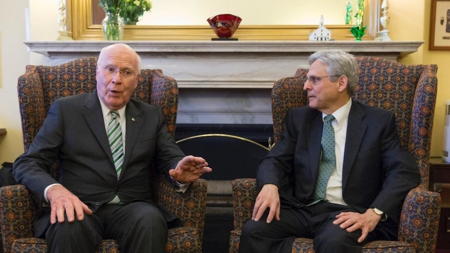 FILE - In this March 17, 2016 file photo, Sen. Patrick Leahy, D-Vt., left, ranking member on the Senate Judiciary Committee, meets with Judge Merrick Garland, President Barack Obama's choice to replace the late Justice Antonin Scalia on the Supreme Court, on Capitol Hill in Washington. Garland, has been characterized as a moderate who, if confirmed, would nudge his divided colleagues slightly to the left because he would replace conservative stalwart Antonin Scalia. (AP Photo/J. Scott Applewhite, File)