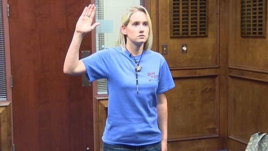 Tammy Barnett takes her oath as the first female infantry recruit.