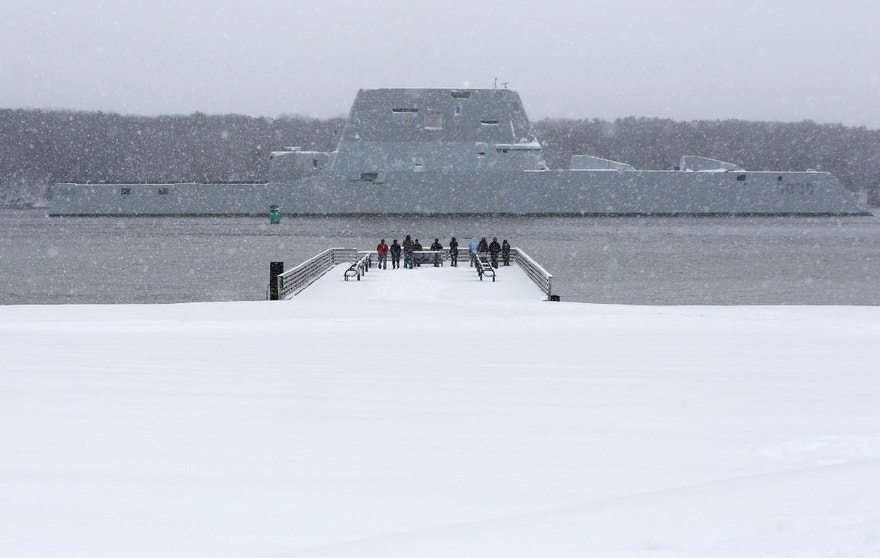 The USS Zumwalt, the Navy's new guided missile destroyer, makes it way down the Kennebec River as it heads out to sea, Monday, March 21, 2016, in Bath, Maine. The new destroyer, which was built at Bath Iron Works, will undergo final builder trials before the ship is presented to the Navy for inspection. (AP Photo/Robert F. Bukaty)