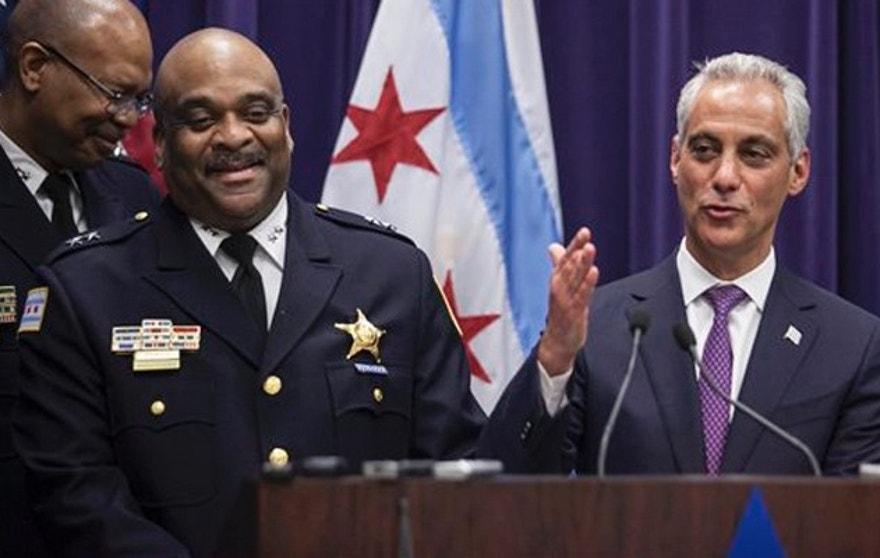 Mayor Rahm Emanuel, right, announces that he is appointing Eddie Johnson, the current Chief of Patrol, as the interim superintendent of the Chicago Police Department at CPD Headquarters in Chicago on Monday, March 28, 2016. Johnson didn't apply for a chance to become Chicago's police chief, but the department's chief of patrol could address many challenges facing Emanuel and a city reeling from a police shooting scandal. (Ashlee Rezin/Chicago Sun-Times via AP)  MANDATORY CREDIT, MAGS OUT, NO SALES; CHICAGO TRIBUNE OUT