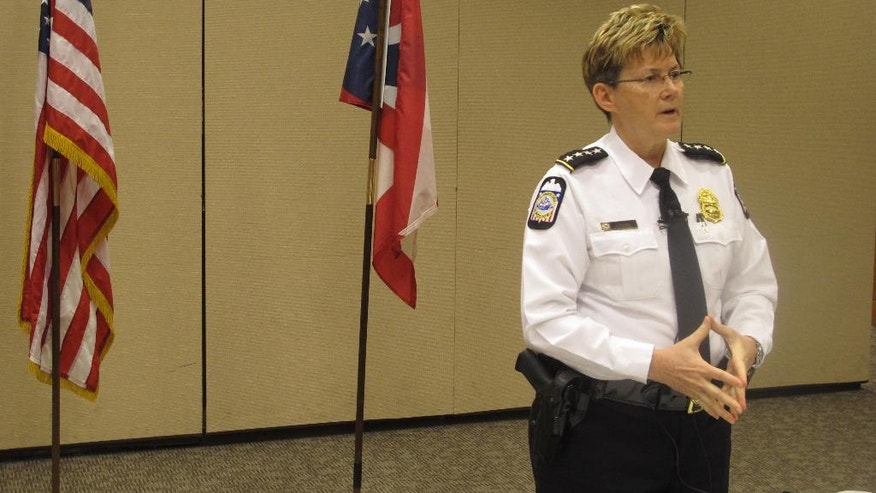 Columbus Police Chief Kim Jacobs discusses a shooting that left a SWAT officer in critical condition as officers attempted to arrest a suspect on an arson charge, on Sunday, April 10, 2016, in Columbus, Ohio. Police said the officer was in a SWAT vehicle approaching the suspect's apartment early Saturday morning when shots were fired, hitting the officer. (AP Photo/Andrew Welsh-Huggins)