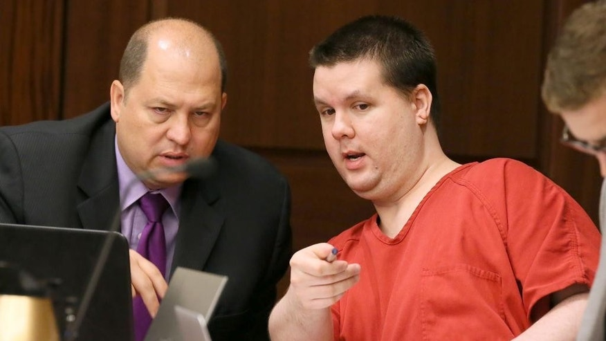 FILE - In this Sept. 15, 2015 file photo, Justin Ross Harris, right, motions to a image on a laptop on the defendant's tables to one of his attorneys, T. Bryan Limpkin, as the pre-trial motion hearings continue in Marietta, Ga.  The trial for Harris, accused of intentionally leaving his toddler son in a hot SUV to die is set to begin Monday, April 11, 2016.  Harris is accused of leaving 22-month-old Cooper to die in June 2014. He's been held without bond since then on multiple charges, including murder. His attorneys have called the death a tragic accident.  (Kelly J. Huff/Marietta Daily Journal via AP, Pool)