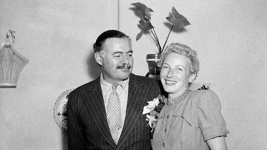 FILE - This March 14, 1946 file photo shows author Ernest Hemingway with his new wife, Mary Welsh, after their wedding in Havana, Cuba. Hemingway and John F. Kennedy never met, but the author's most extensive personal collection is housed at JFK's presidential library and is now on public display. The exhibition opening Monday, April 11, 2016, in Boston includes original manuscripts of some of his most famous literary works; letters to other major literary figures of his time; photographs and other personal mementos. (AP Photo, File)