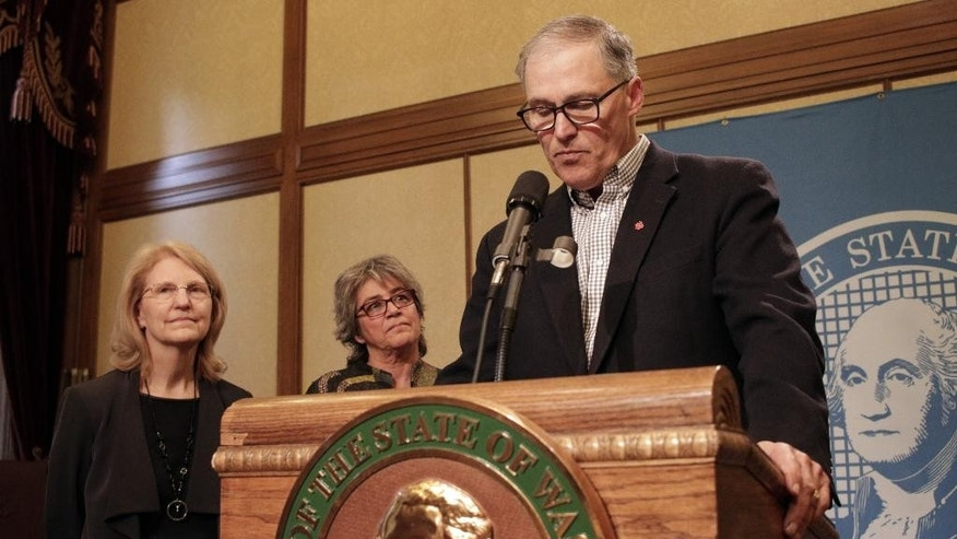 Washington Gov. Jay Inslee announces that Cheryl Strange, second from left, is the new head of Western State Hospital as Pat Lashway, secretary of the Department of Social and Health Services, left, looks on, during a news conference, Tuesday, April 12, 2016, in Olympia, Wash. Strange replaces former Western State Chief Executive Officer Ron Adler, who was fired after a man charged with murder escaped from the facility last week, the latest in a litany of problems at the 800-bed hospital. (AP Photo/Rachel La Corte)