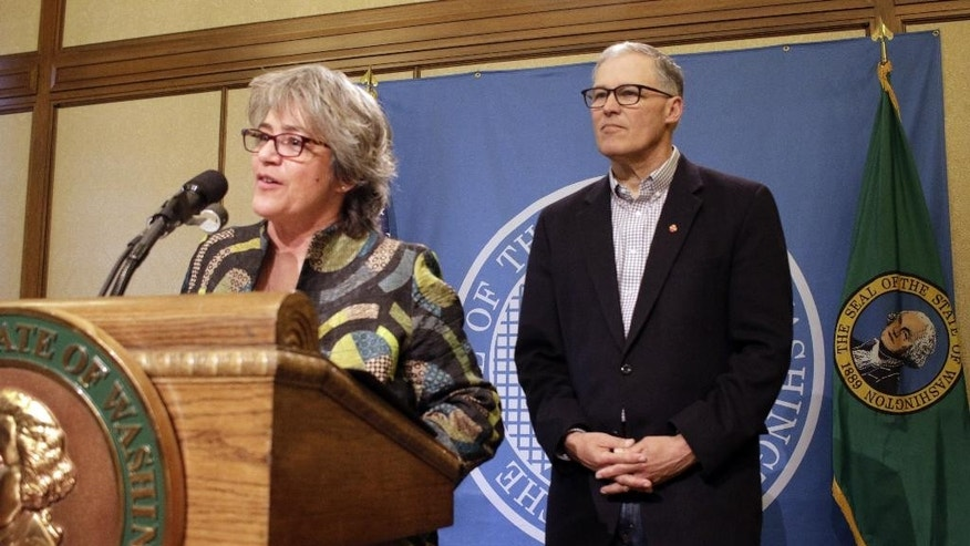 Cheryl Strange, the new head of Western State Hospital, talks to the media as Washington Gov. Jay Inslee looks on, during a news conference, Tuesday, April 12, 2016, in Olympia, Wash. Strange replaces former Western State Chief Executive Officer Ron Adler, who was fired after a man charged with murder escaped from the facility last week, the latest in a litany of problems at the 800-bed hospital. (AP Photo/Rachel La Corte)