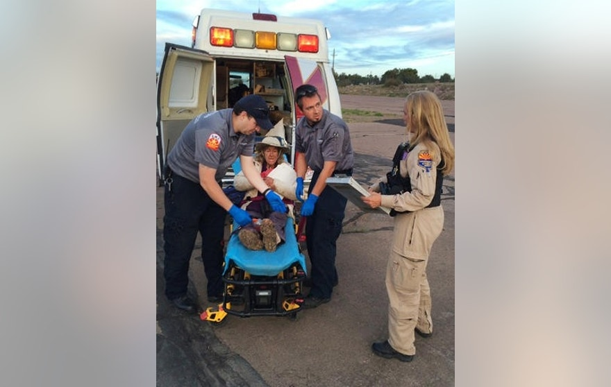 "This photo taken, Saturday, April 9, 2016, and provided by Arizona Department of Public Safety shows an ambulance taking Ann Rodgers, 72 , to safety after she was lost in the forest for nine days. Rodgers got lost in the White Mountains in eastern Arizona after her hybrid car ran out of gas and battery on March 31. Rodgers survived in the forest for nine days by drinking pond water and eating plants. Authorities came across her dog April 9, and a DPS flight crew spotted a ""help"" signal made of sticks and rocks on the ground. Rodgers had left the area, but she was found on a reservation that's home to the White Mountain Apache Tribe after starting a signal fire.  (Arizona Department of Public Safety via AP)"