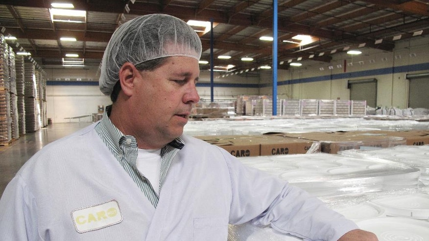 In this Wednesday, April 13, 2016 photo is Todd Crosswell, general manager of Caro Nut Co. at the company's nut processing plant in Fresno, Calif. Sophisticated thieves stole six truckloads from Caro Nut last year at a loss of $1.2 million to the firm. The scheme has cost the California nut industry nearly $7.6 million dollars in the last four years. In some cases, the thieves with international ties use fake shipping papers to assume the identity of legitimate firms to steal truckloads worth between $150,000 and $500,000 each. (AP Photo/Scott Smith)