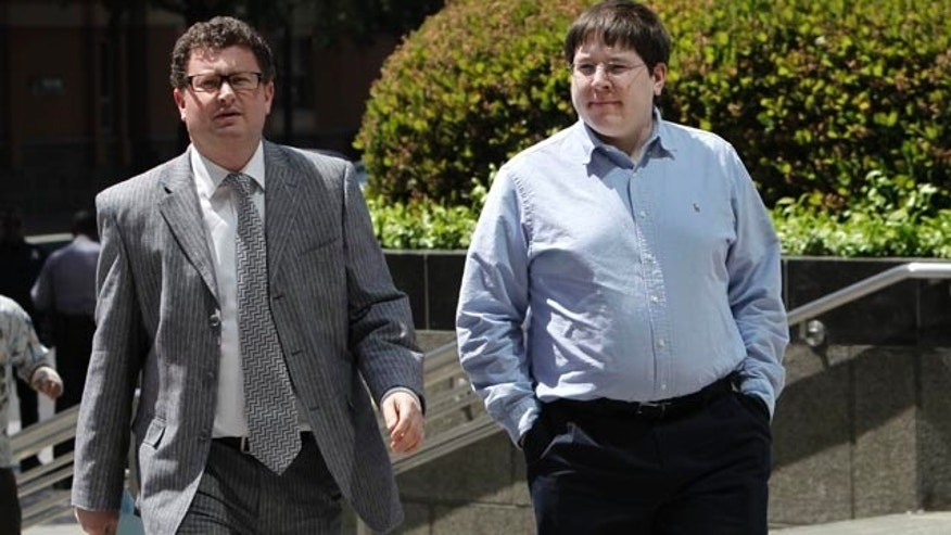 Matthew Keys, right, with his attorney Jason Leiderman in 2013.