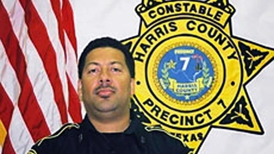 In this undated photo released by Harris County Sheriff's Office, Harris County Deputy Constable Alden Clopton is seen. Clopton was shot multiple times from behind late Wednesday, April 13, 2016, while talking to another constable following a traffic stop in Houston. Clopton was wearing a protective vest when he was shot and is expected to recover after undergoing several hours of surgery. (Harris County Sheriff's Office via AP)