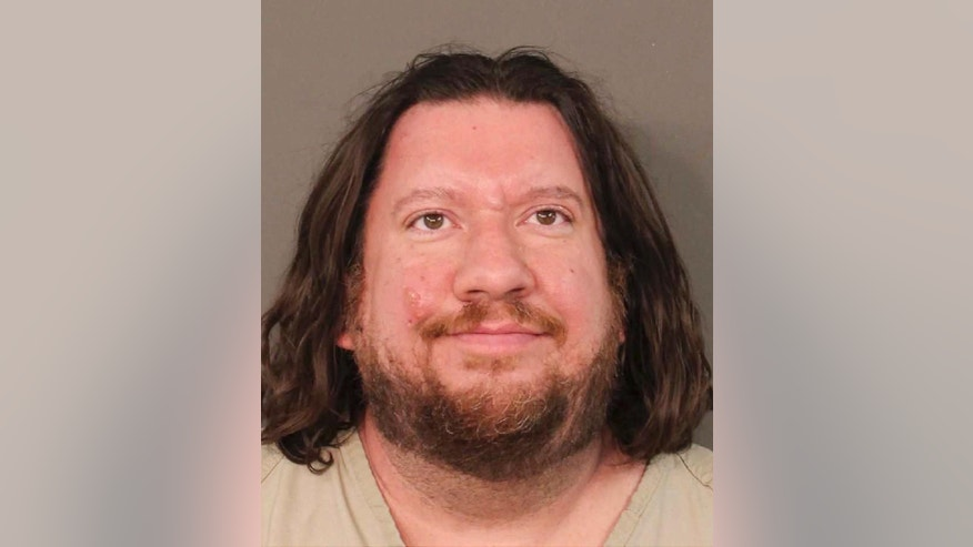This photo provided by the Franklin County Sheriff's Office in Columbus, Ohio, shows Lincoln Rutledge. Rutledge is accused of opening fire on a SWAT team trying to arrest him and critically wounding an Ohio police officer who remains on life support. A Franklin County judge on Tuesday ordered the 44-year-old Columbus resident held without bond on charges including felonious assault and aggravated arson. (Franklin County Sheriff's Office via AP)