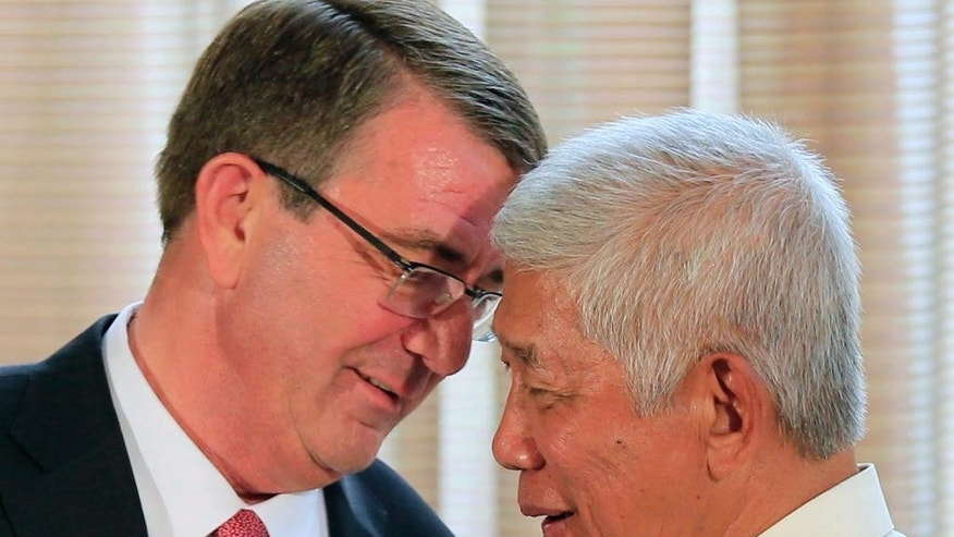 U.S. Defense Secretary Ash Carter, left, talks with his Philippine counterpart Voltaire Gazmin during their joint press conference at the Malacanang presidential palace in Manila, Philippines on Thursday, April 14, 2016. The United States on Thursday revealed for the first time that American ships have started conducting joint patrols with the Philippines in the South China Sea, a somewhat rare move not done with many other partners in the region. (Romeo Ranoco/Pool Photo via AP)