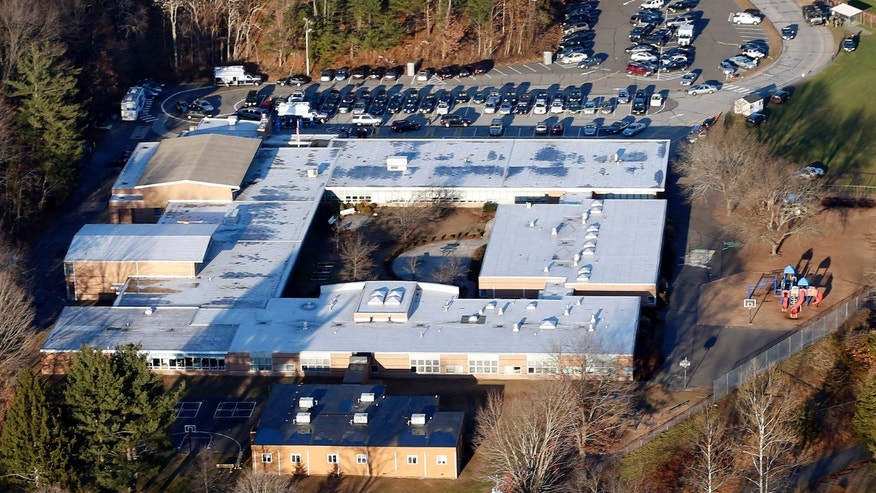 This Dec. 14, 2012 aerial file photo shows Sandy Hook Elementary School in Newtown, Conn. Newtown, Conn.