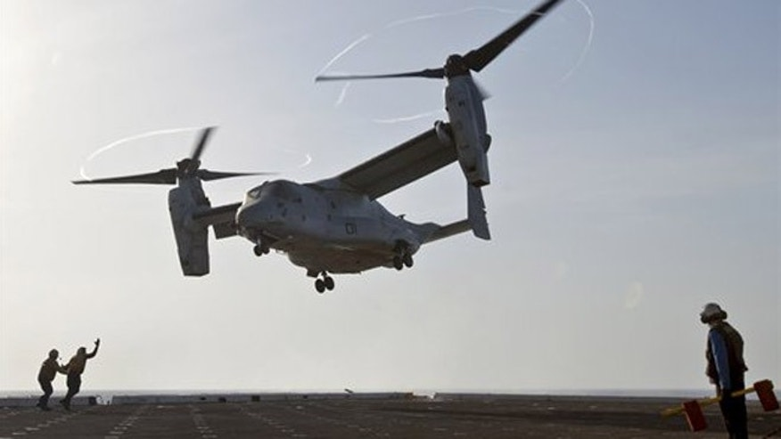 U.S. sailors aboard the amphibious transport dock ship USS Mesa Verde guide a U.S. Marine Corps MV-22 Osprey aircraft as it departs the Mesa Verde to support operations in the Persian Gulf in 2014. (Department of Defense)