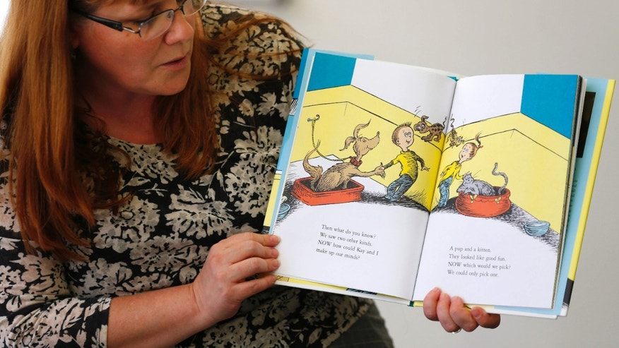 """July 28, 2015: Reference librarian Marlayna Christensen reads to children Dr. Seuss' new book """"What Pet Should I Get?"""" at the University of California San Diego's Geisel Library in San Diego."""